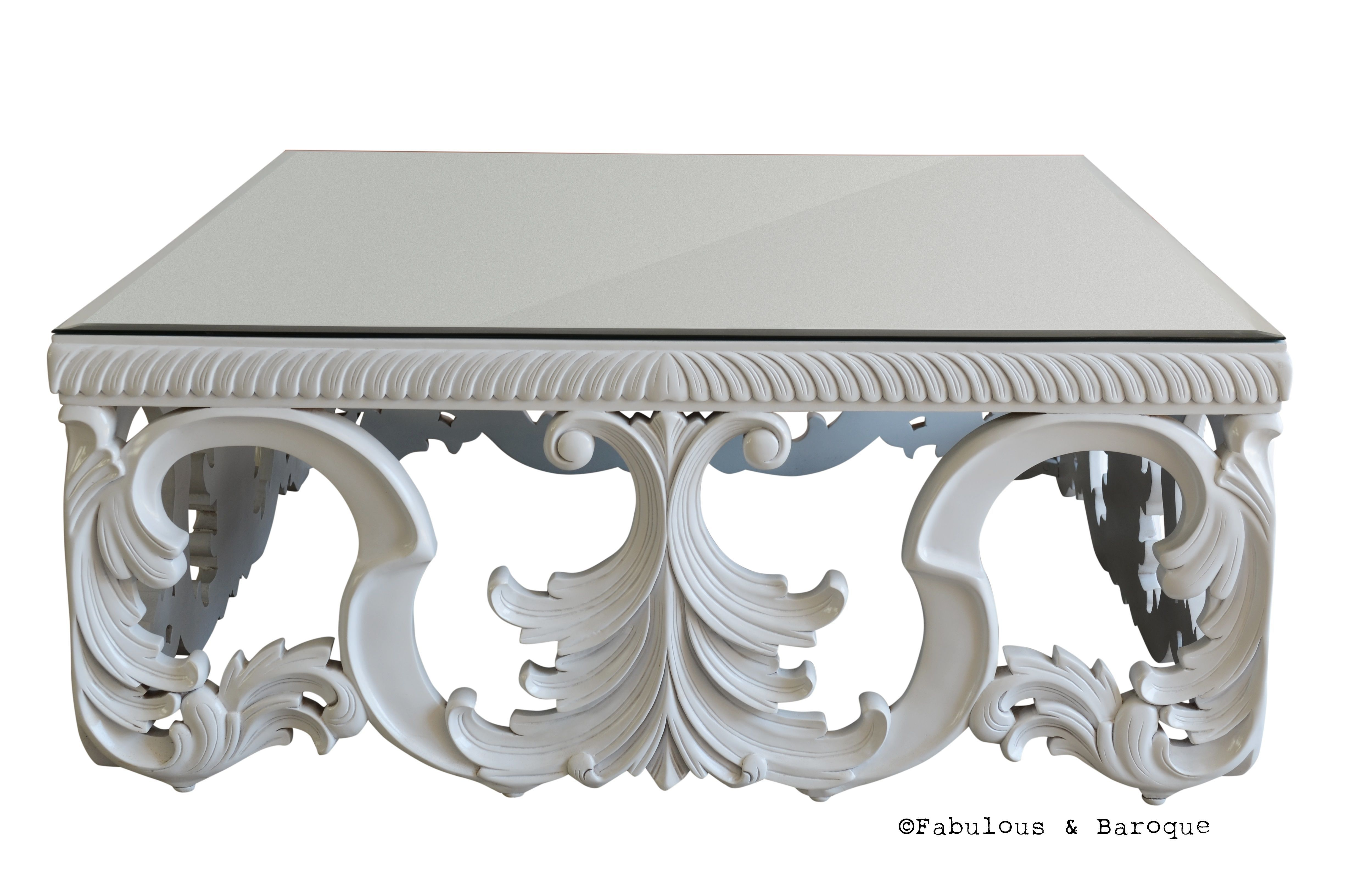 Looking for a fabulous twist on the traditional coffee table look fabulous twist on the traditional coffee table othello coffee table features intricate baroque details and a magnificent smoked glass top with a mirrored geotapseo Image collections