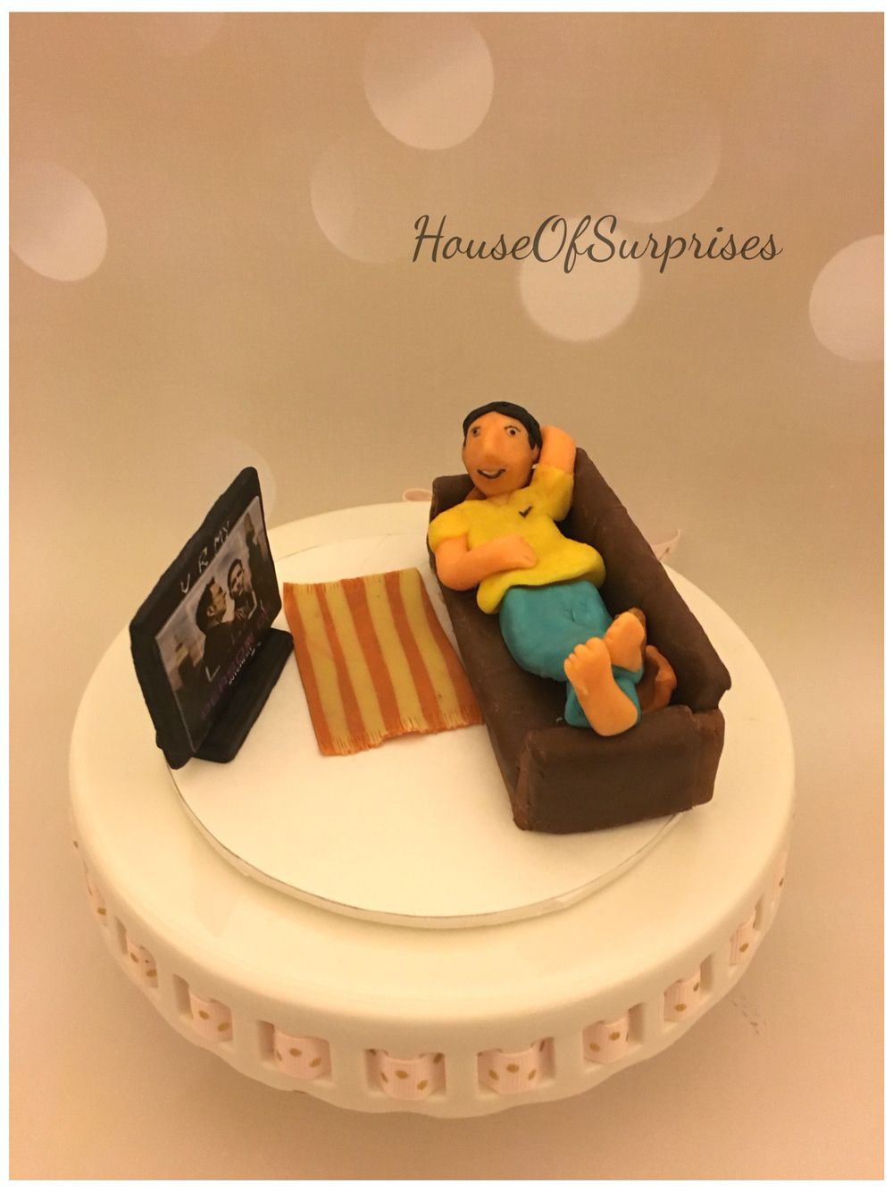 Person of interest cake, man relaxing on couch with PI running on ...