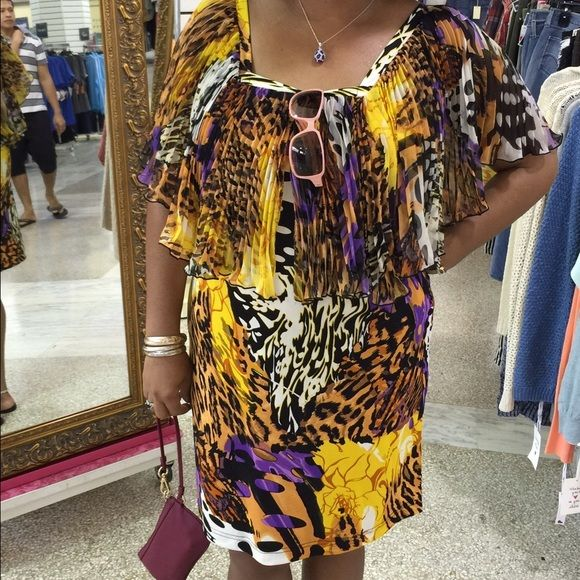 African print dress Sleeveless dress with overlay of pleated fabric to cover shoulders. Knee length and very comfy. Over head no zippers or buttons. Madison Paige Dresses