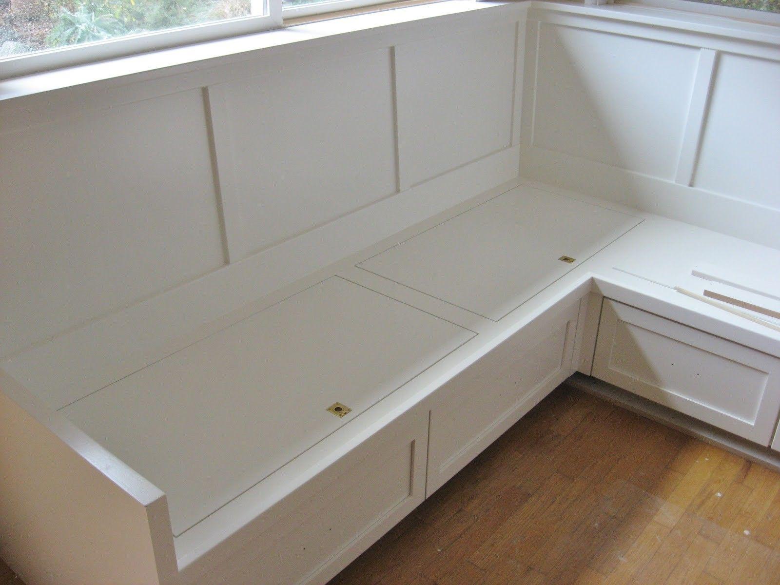 White wooden corner storage bench on brown laminated wooden floor with white breakfast nook with storage also modern kitchen nook furniture