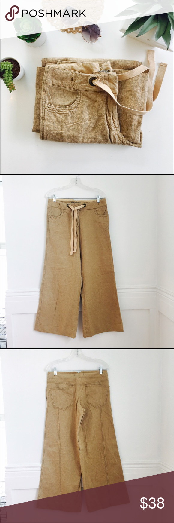 Hei Hei pants NEW WITHOUT TAGS. Tan color, wide leg cropped pants in cotton and linen. Hook & eye and zip closure, plus drawstring waist. Front and back pockets. Anthropologie Pants