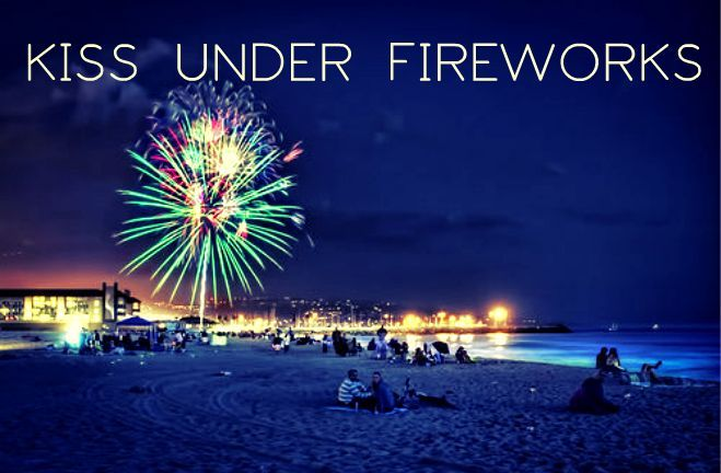 kiss under fireworks on the fourteenth of july in france on the beach