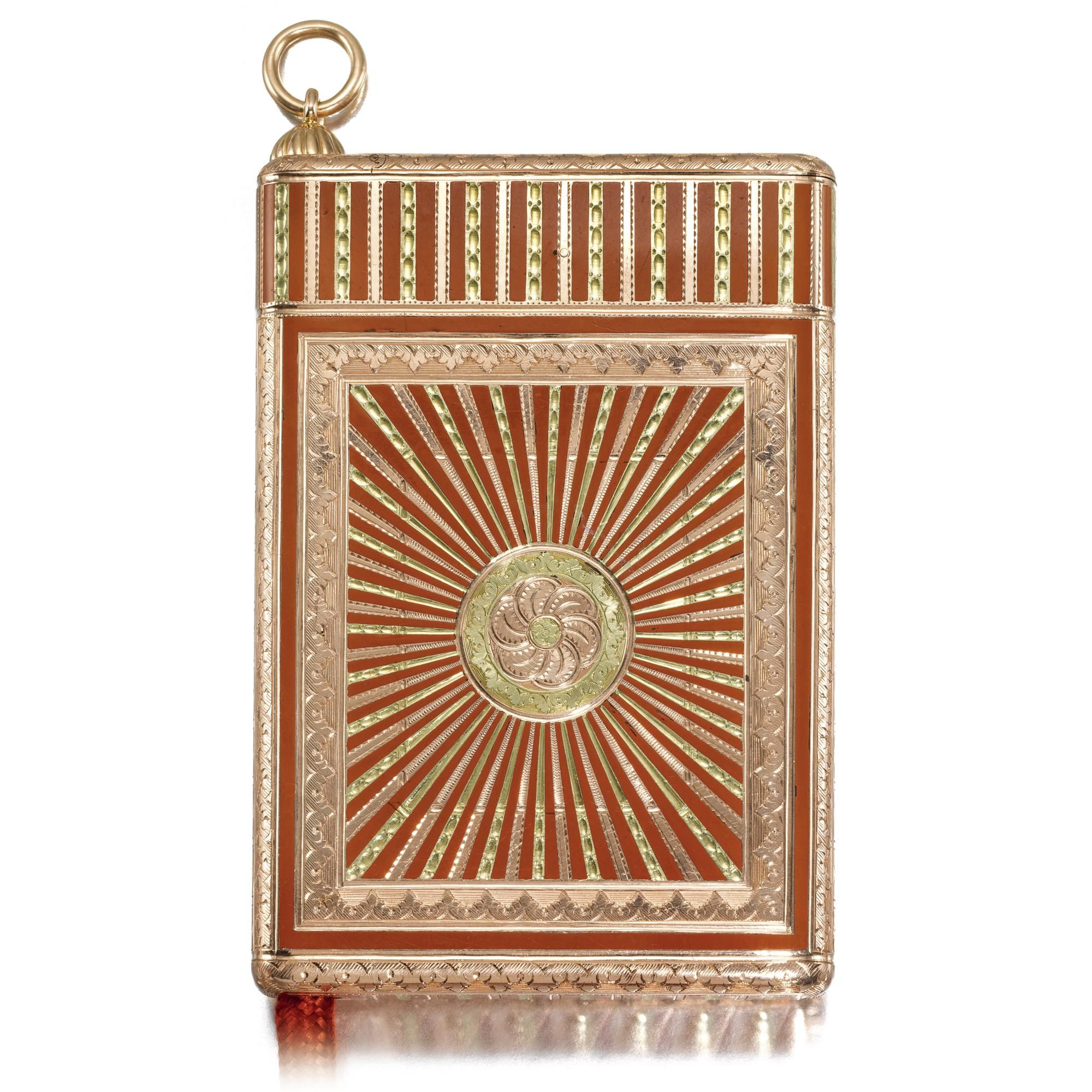 A RARE FABERGÉ LACQUERED TWO-COLOUR GOLD CIGARETTE CASE, WORKMASTER MICHAEL PERCHIN, ST PETERSBURG, CIRCA 1895 the surface of cinnabar lacquer within vari-coloured gold stripes and rays, the lid and base centred with a rosette within acanthus tip borders, the end with vesta compartment containing vestas, red tinder cord, struck with workmaster's initals, 56 standard