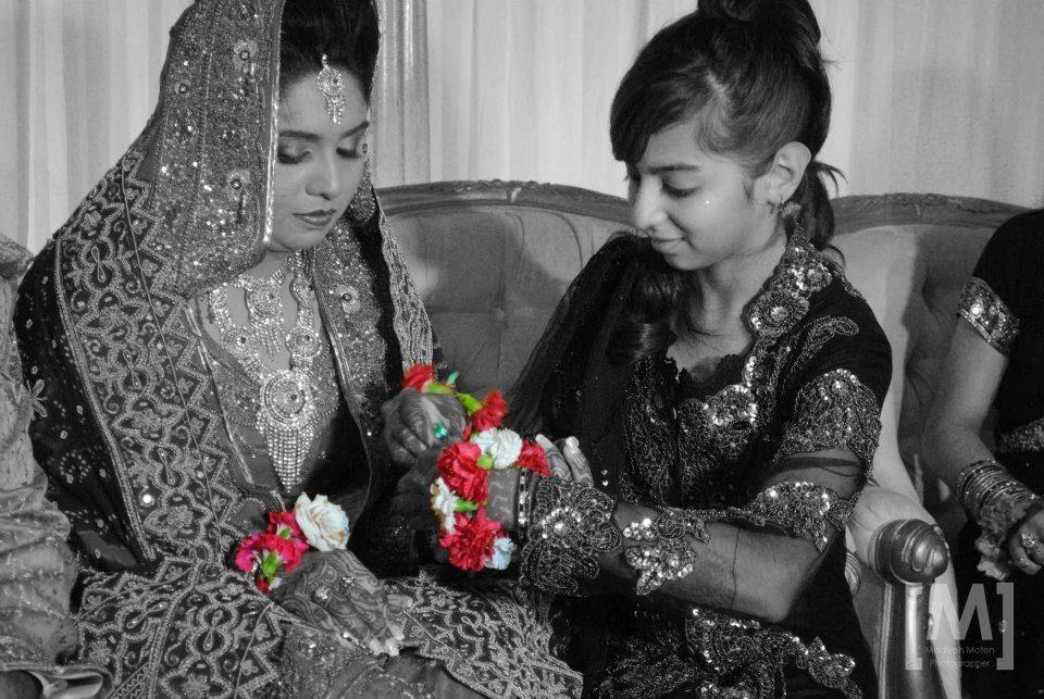 e40dddd5eb Desi wedding - flower bracelet - action shot - Studio M Photography ...