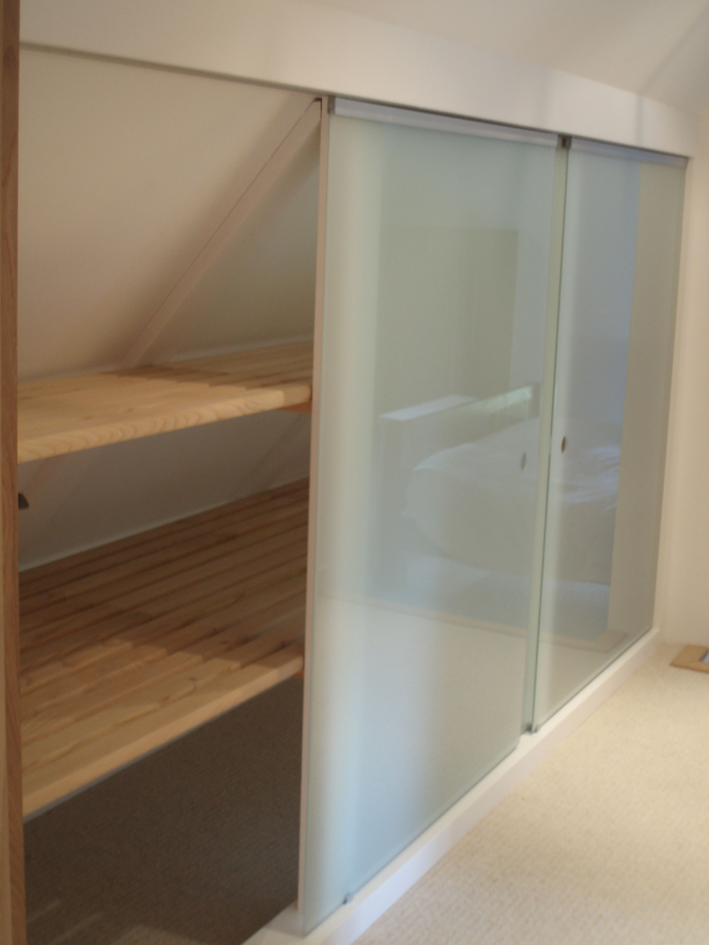 An Under Eaves Storage Cupboard With