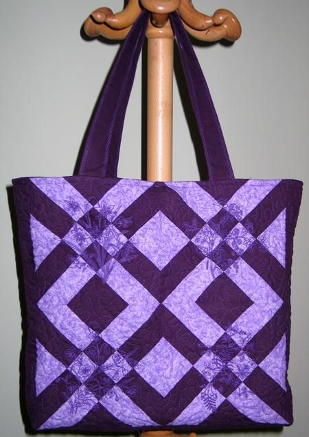 Advanced Embroidery Designs. Free Projects and Ideas. Tote -bag quilted with redwork designs.  http://www.advanced-embroidery-designs.com/projects_2009/guide_violet_tote.html