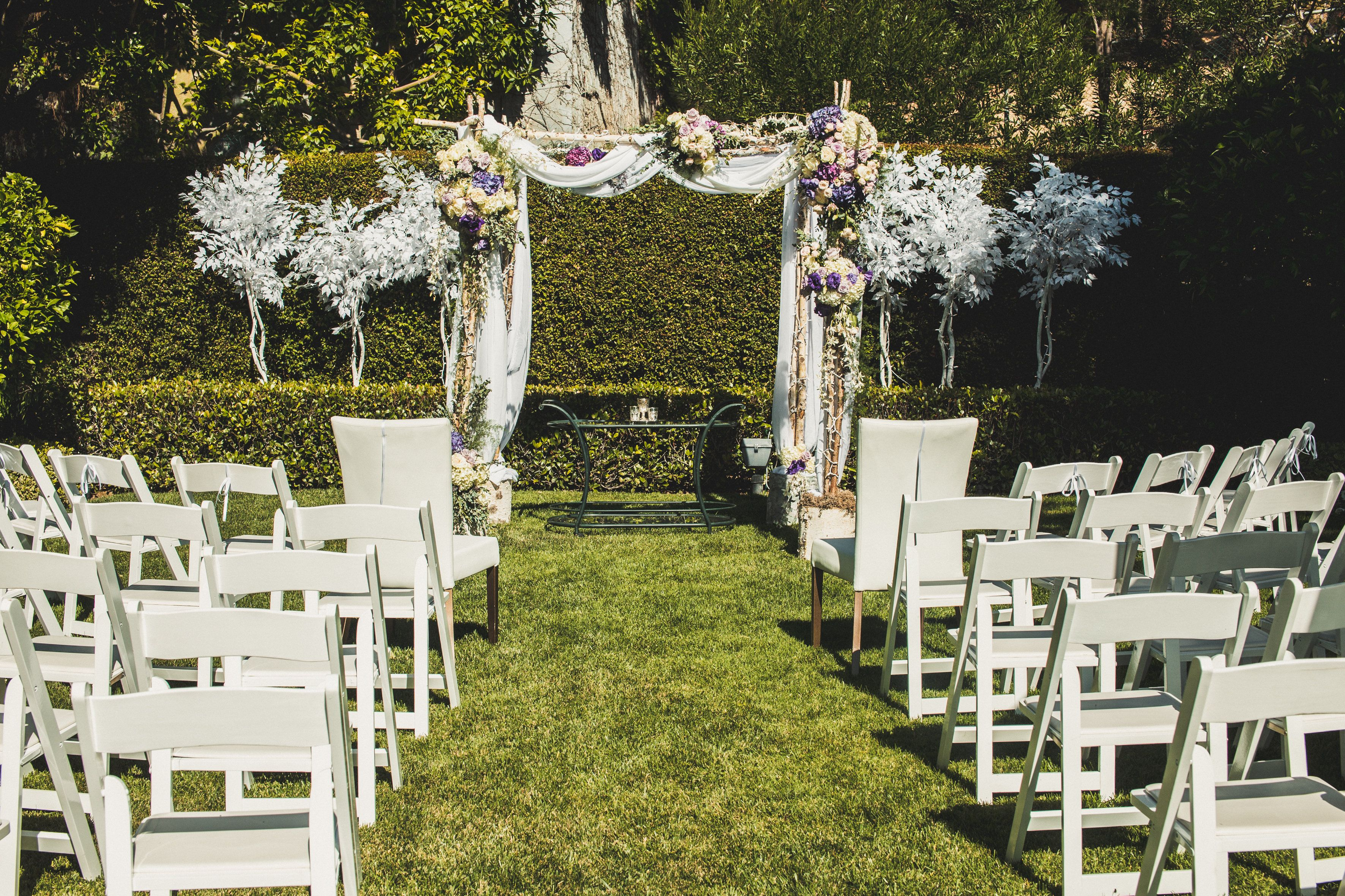backyard wedding chuppah chuppa white green lavender
