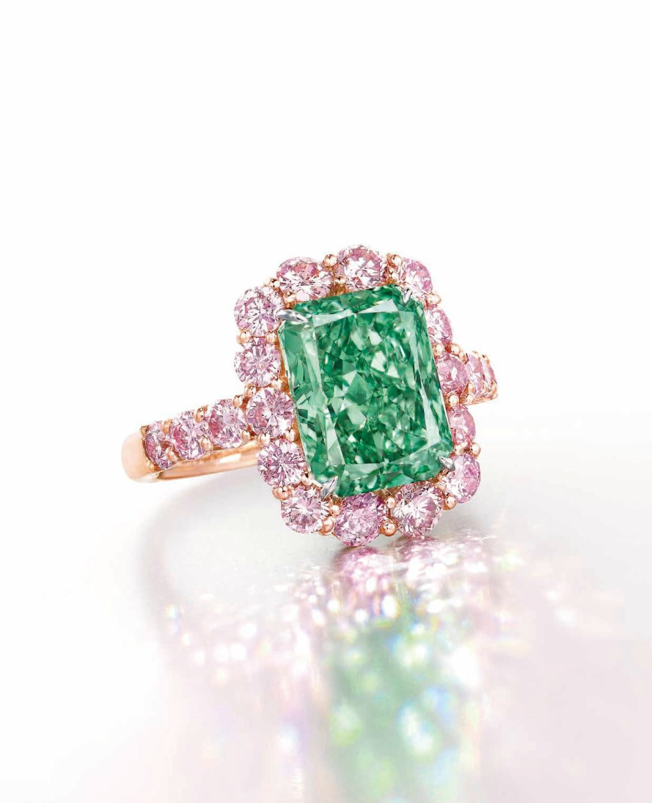 A SUPERB COLOURED DIAMOND RING. Set with a rectangular-cut fancy vivid green diamond, weighing approximately 5.03 carats, within a circular-cut pink diamond surround, extending to the shoulders, mounted in gold, ring size 6. Price Realised USD 16,818,983 // Estimate USD 16,000,000 - USD 20,000,000. GIA / Fancy Vivid Green colour, VS2 clarity [C. Hong Kong Magnificent Jewels - 31 May 2016 - Convention Hall] #Christie's #Auction #Vivid #GreenDiamond