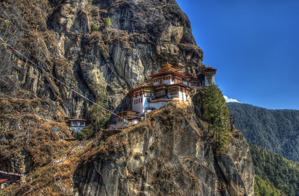 One of the world's most remote temples, the Tiger's Nest (or Paro Taktsang) is all worth of time and efforts to get there. Not only is it stunningly beautiful and serene, but it gives you a chance to uncover yet another secret of happiness that Bhutanese people know.