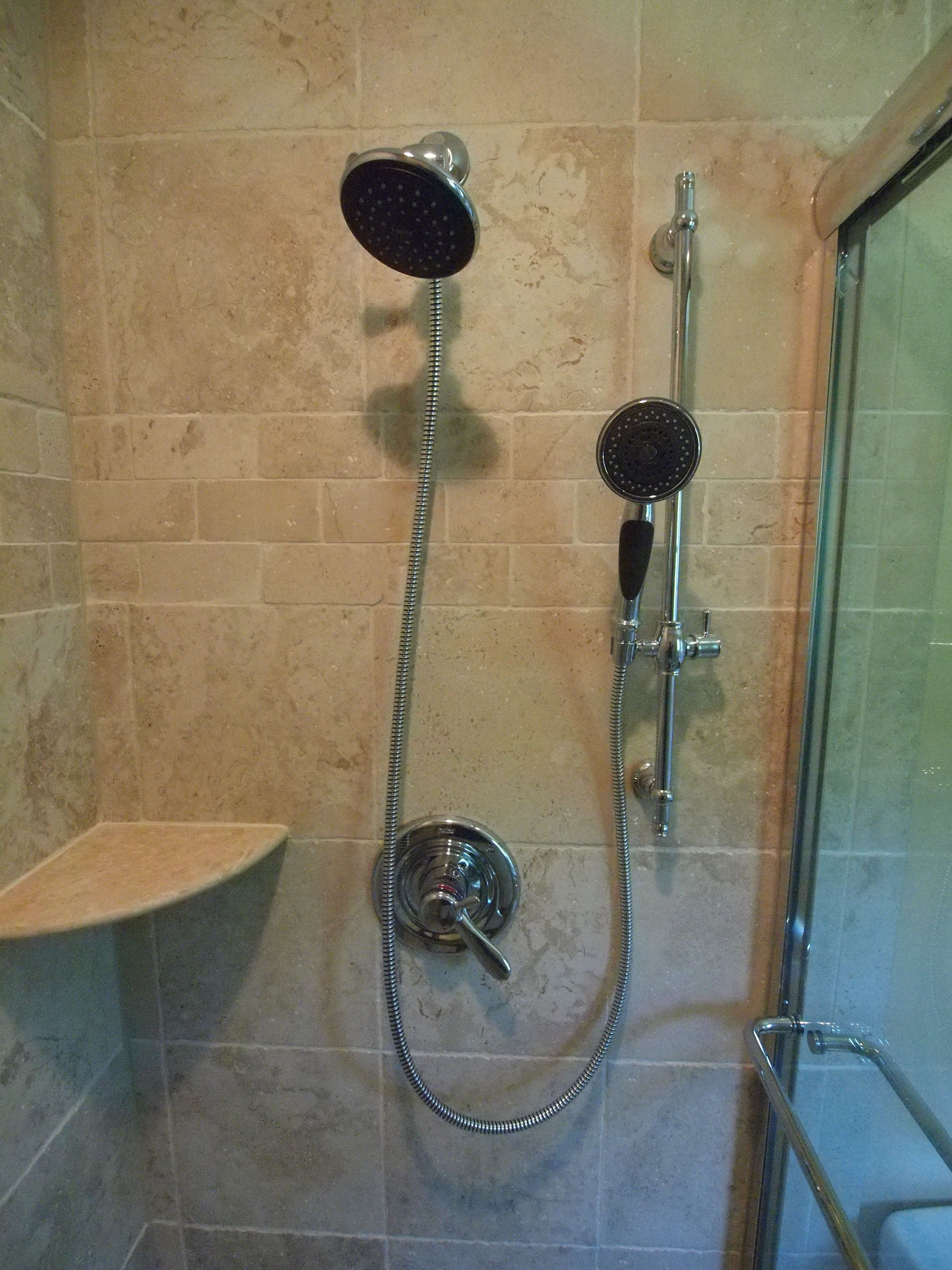 Delta Shower Trim With A Separate Hand Held Shower On A Slider Bar