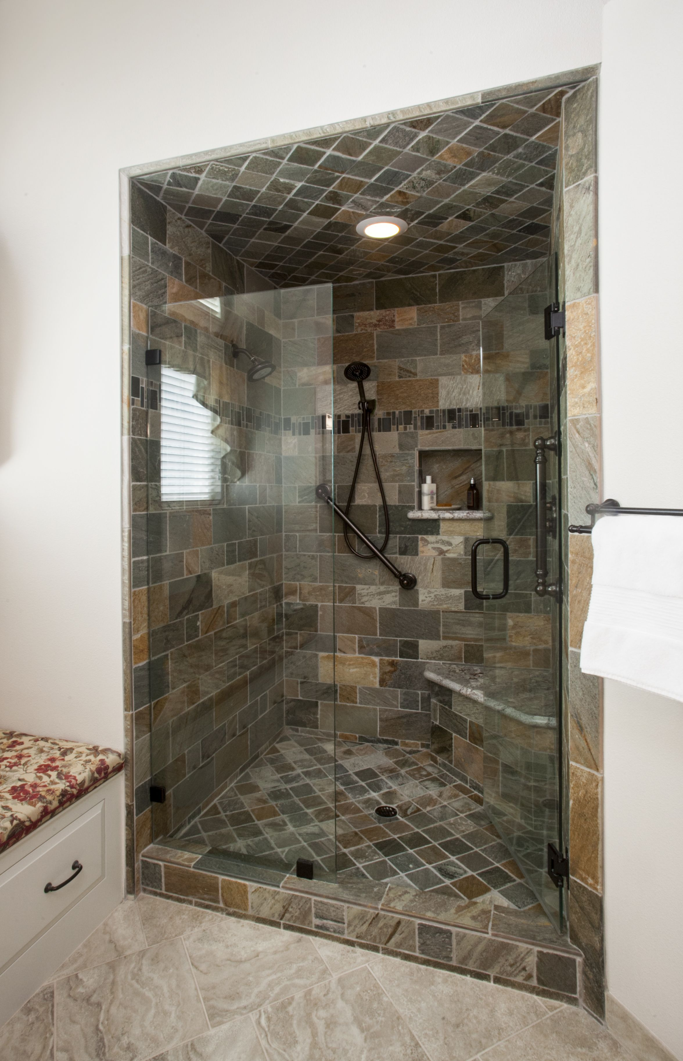Stand in shower, with seating and hidden soap dispenser.   Bathroom ...