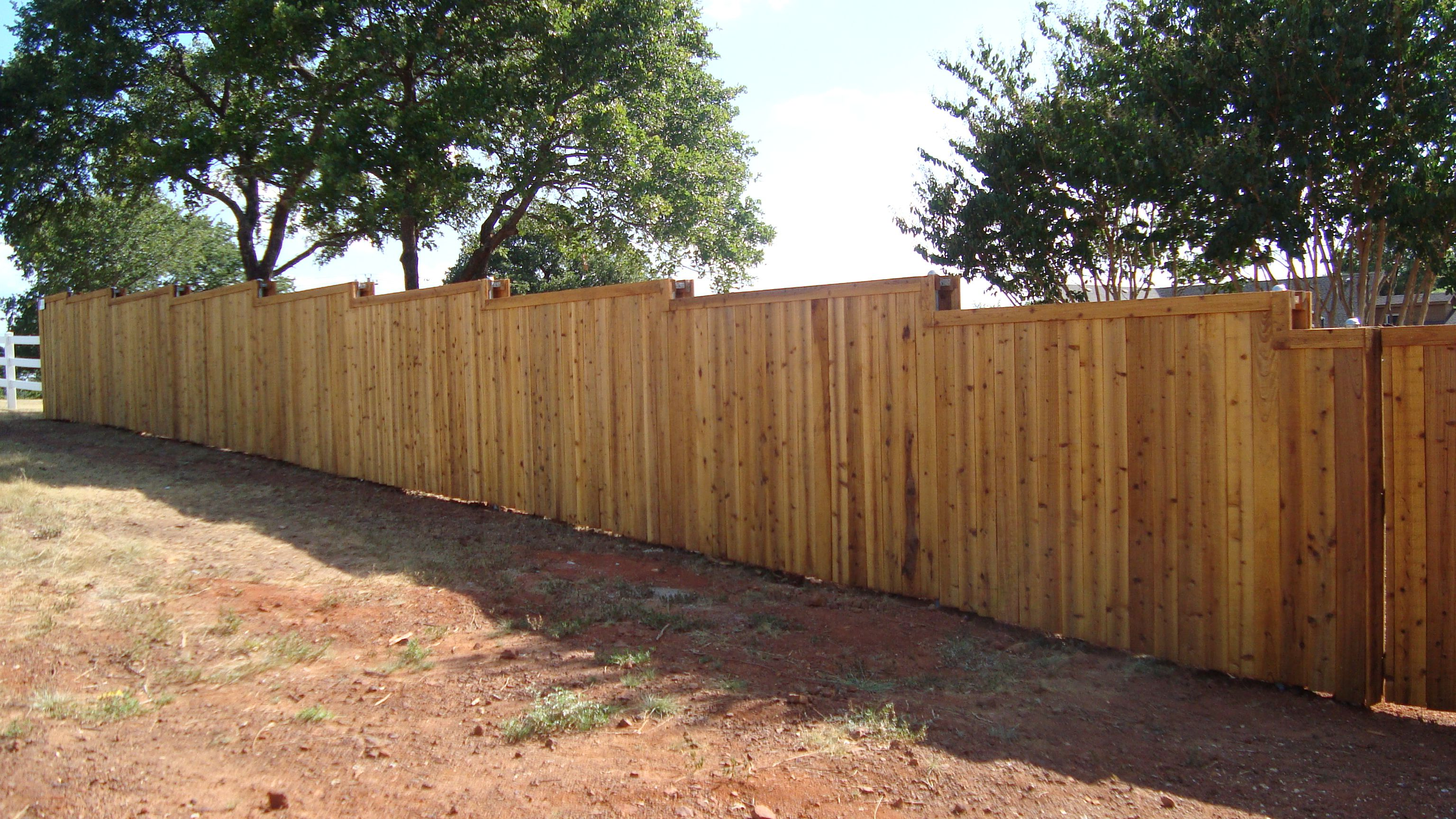 Raw Board On Board Double Sided Fence With Trim Installed By