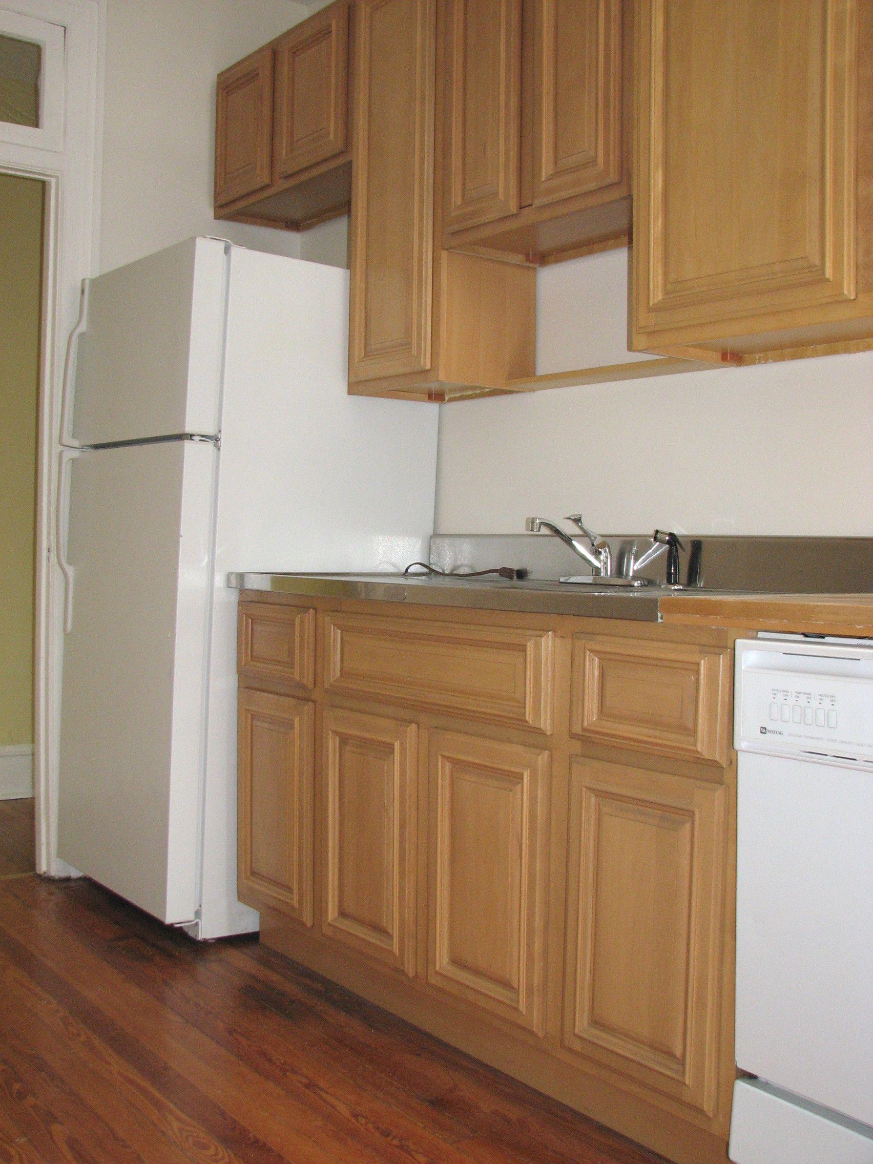 Best Honey Maple Kitchen Cabinets And Dark Floor 400 x 300