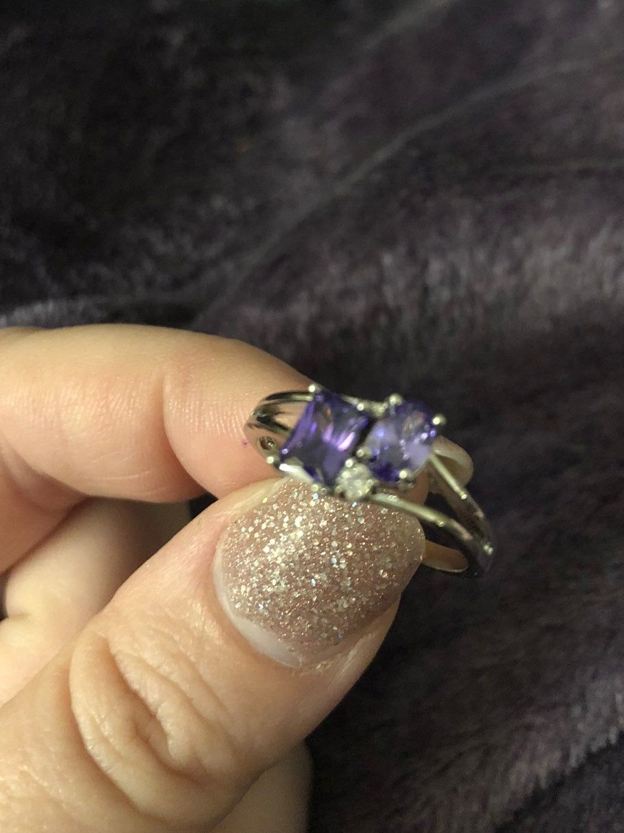 Bubbly Belle Ring With Its Own Reveal Code For The Listed Worth Of The Ring There Are Two Beautiful Royal Purple Stones And One C Rings Purple Stones Bubbles
