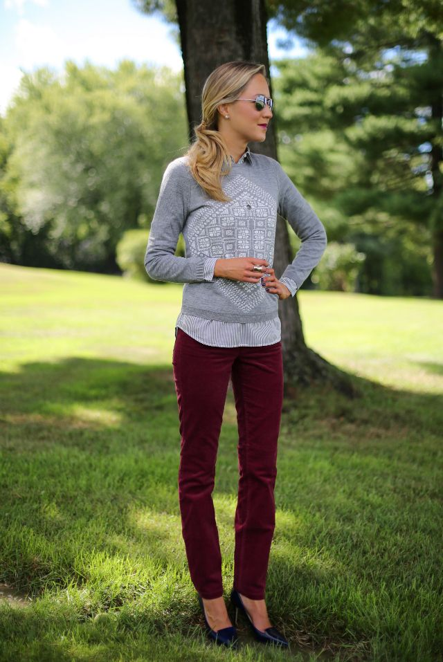3d8a98f45e Burgundy corduroy skinny-leg pants with gray sweater over striped blouse