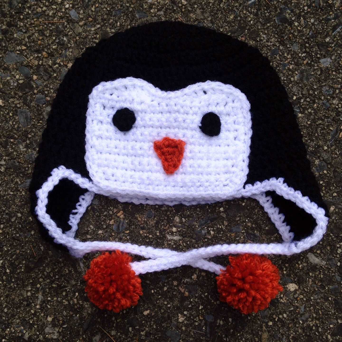 81a242b24a00f Crochet penguin earflap hat on Etsy by Knockout Kreations in all sizes.  Kids penguin costume. Newborn photo prop. Baby penguin hat. Kids penguin  hat.