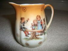 Vintage Miniature milk jug - 1930s, children on seesaw