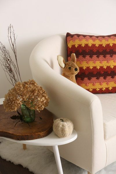 The spike cluster stitch makes gorgeous Japanese maple leaves on this pillow. Beautiful fall tones make the pattern on this pillow stand out in a striking way.