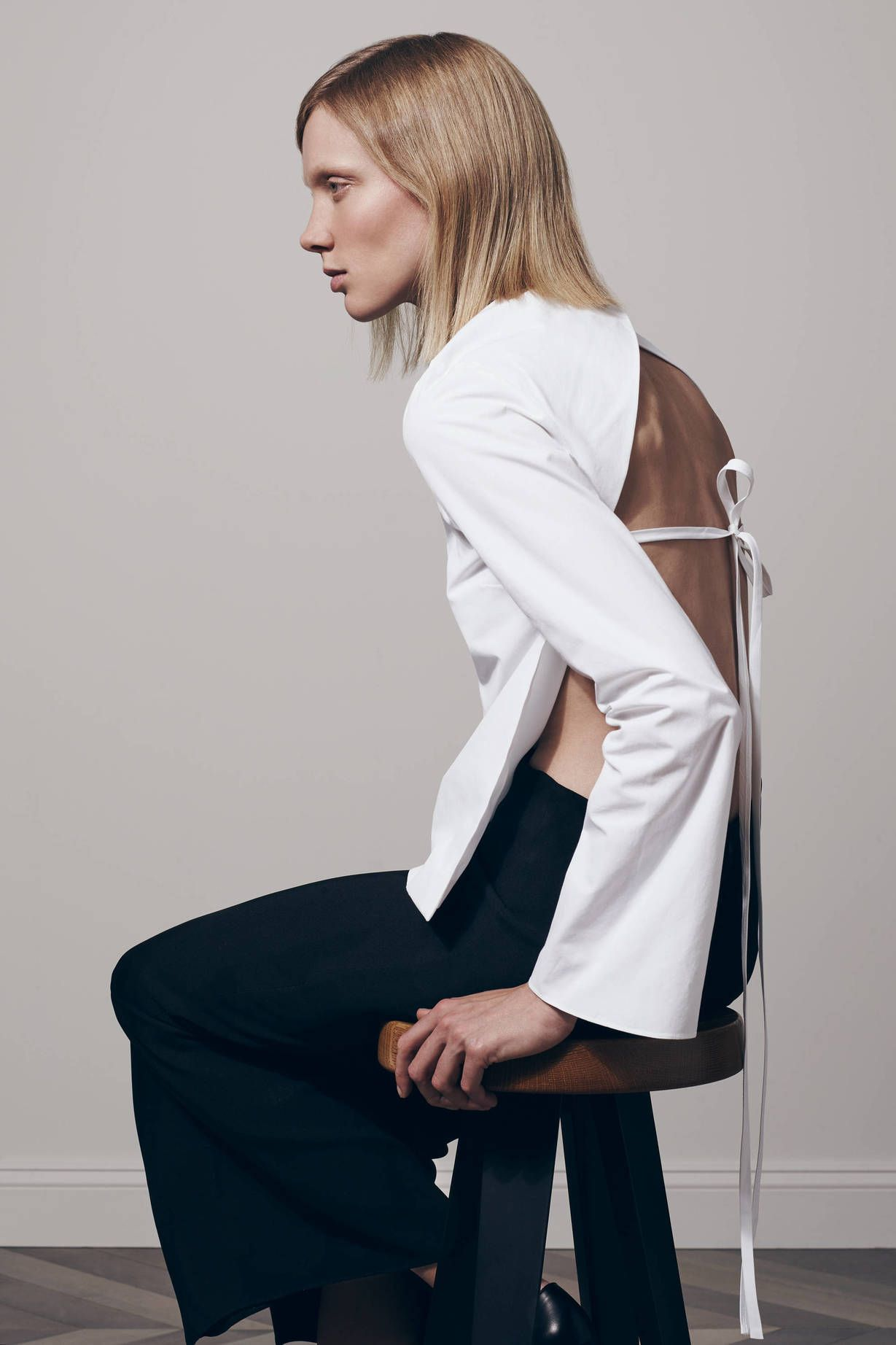 Minimal white shirt with open back detail, contemporary fashion // Protagonist