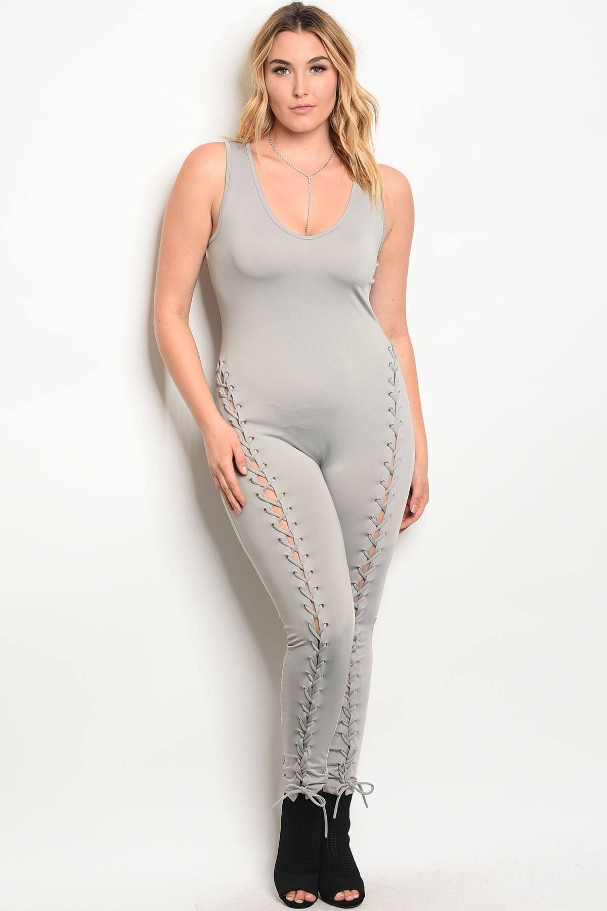a68c9318347 Plus size spandex blend jumpsuit with lace up details along the leg and a v  neckline