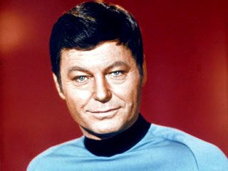 (Played by DeForest Kelley) STARFLEET HISTORICAL FILE: McCoy, Leonard H. Mid-level Biography Brief Mode  Final Rank: Admiral, retired Full Name: Leonard H. McCoy, M.D. Year of birth: 2227 Parents: Mr. and Mrs. David McCoy Education: University of Mi...