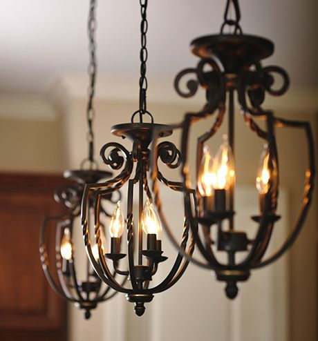 Three wrought iron hanging pendant light fixtures ...