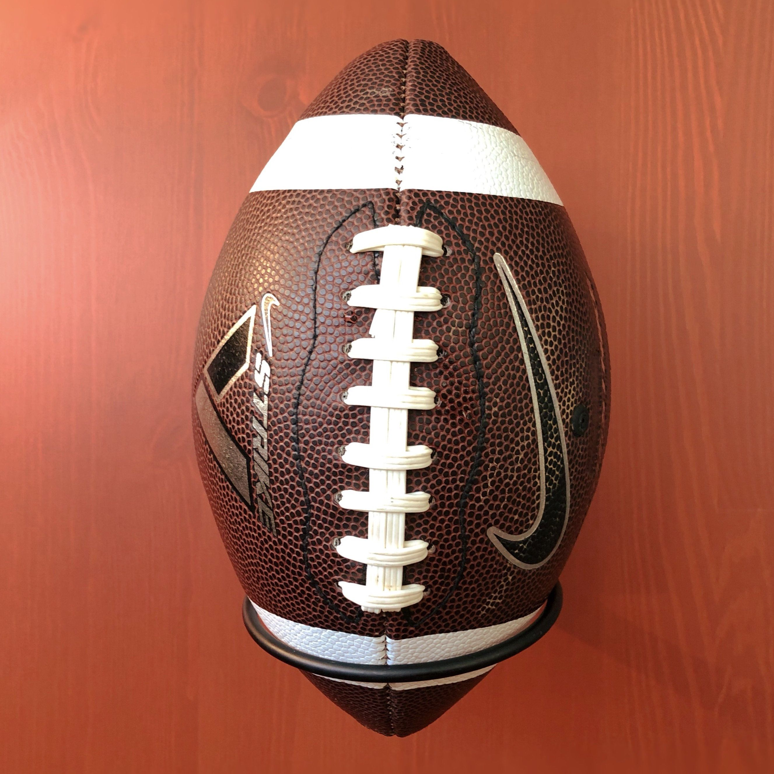 Football wall mounted holder for garages basement kids