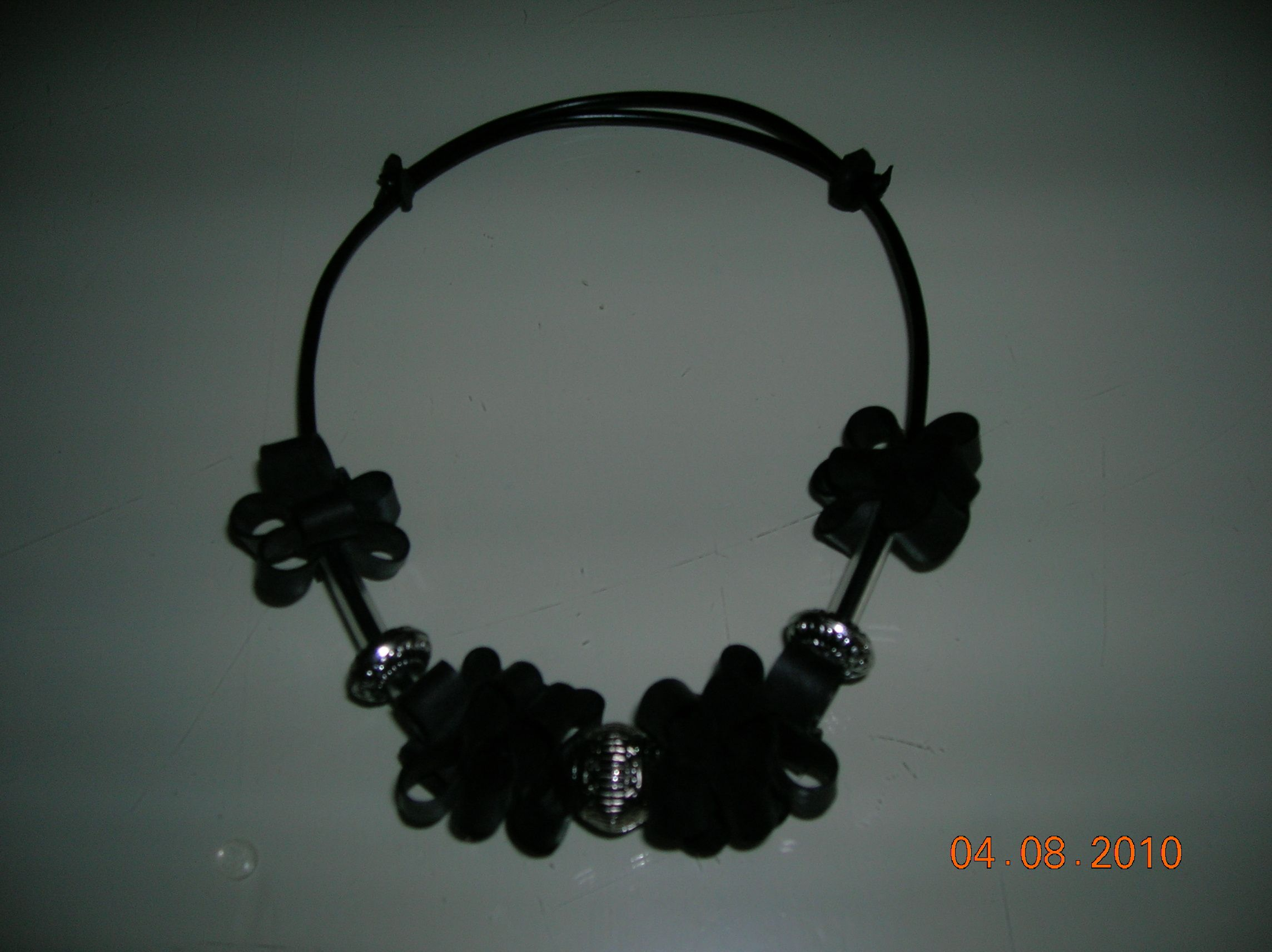 necklace of beads and old bicycle tires