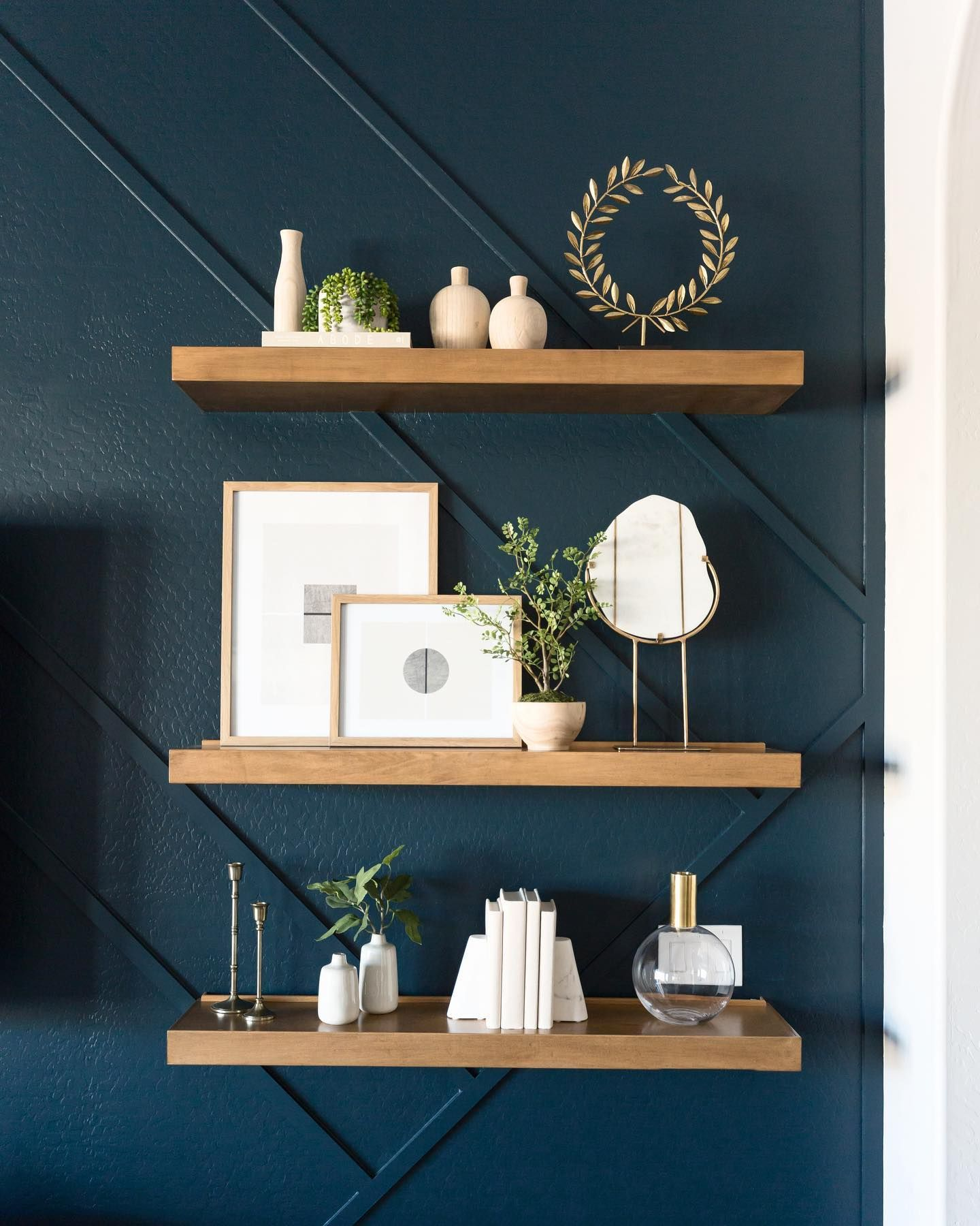 Here S A Closeup Of The Floating Shelves On The Dark Blue Wall From The Heyneighborproject I Blue Wall Decor Living Room Blue Wall Decor Interior Wall Design