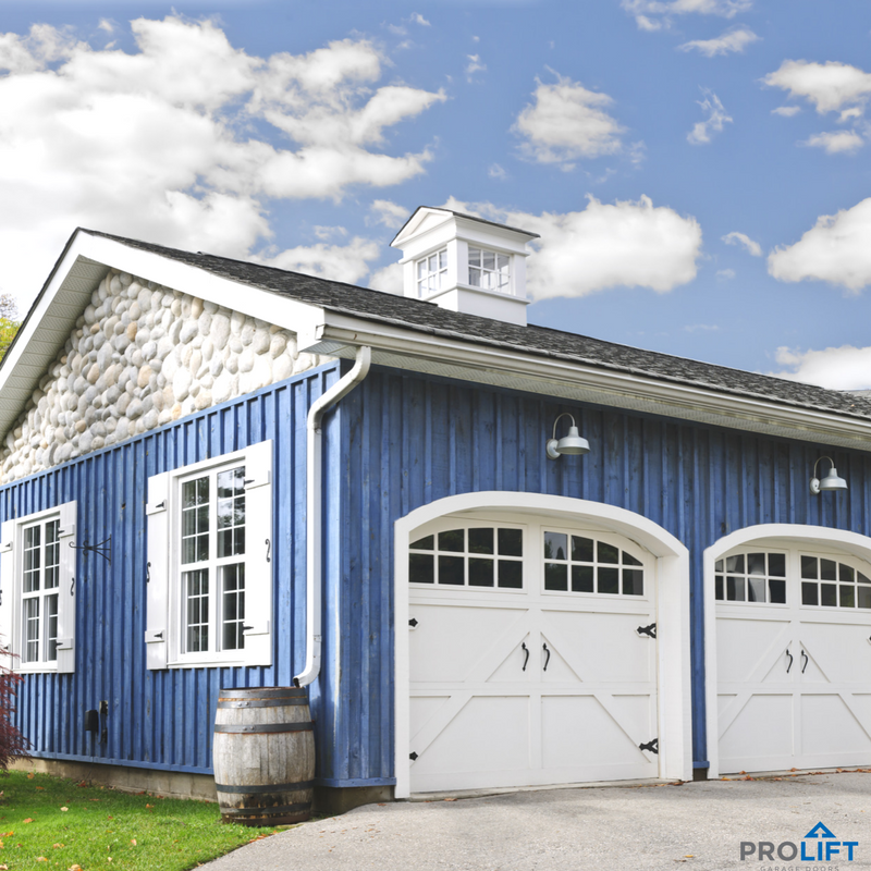 Inspired By The Look Of Classic Barn Style These White Carriage House Garage Doors Pack Loads Of Character Garage Door Styles Garage Door Design Garage Doors
