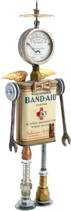"""Name: Health Angel 6.0  D.O.B.: 10/23/11  Height: 12""""  Principal Components: Band-Aid tin, pocket battery tester, clock gear, wrenches, hydraulic fittings, spring.  Amy Flynn Designs."""