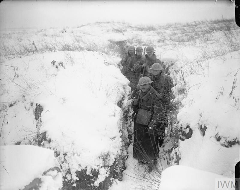 WWI, Feb 1917; British troops coming out of a communication trench ...