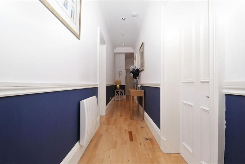 My hall - farrow and ball Hague blue, but with skimming stone or cornforth white on the top