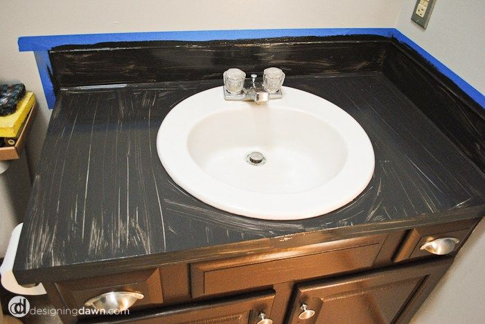 Well, I've been promising bathroom updates and I have some good ones! It starts here, with a new(ish) counter top. I say new-ish, because while we're on a very miniscule budget for this bathroom makeover and couldn't afford to replace the counter top right now...