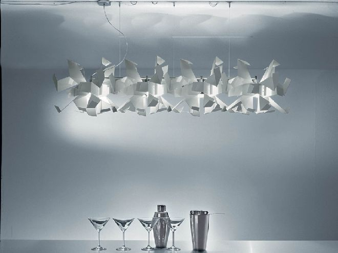 Glow Pendant 3 / 4 is the starting point for the design of this group of lamps was the aesthetic expression of light splintering off titanium walls. Its inspiration stems from the Guggenheim museum in Bilbao. Available in different versions at design2taste.com