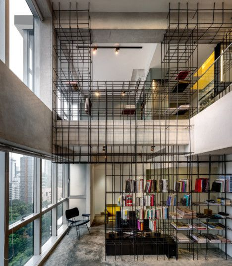 Steel Rod Grid Criss Crosses Apartment As Storage Art With