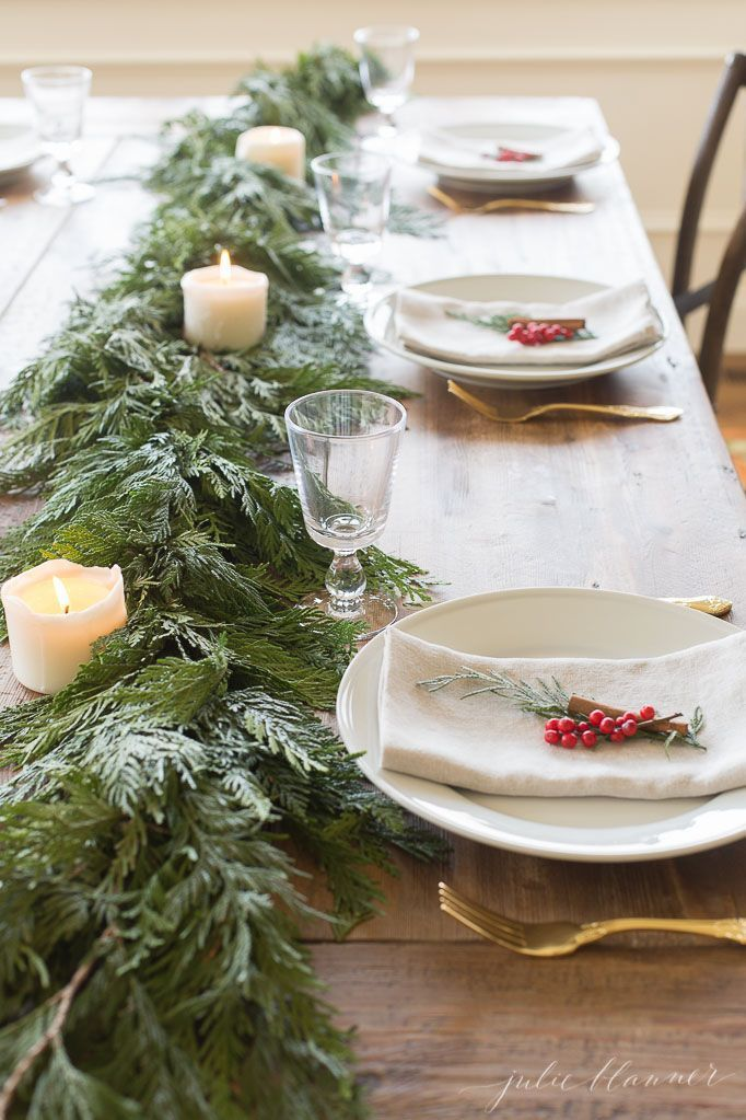 Red And Green Garland Centerpiece And Christmas Table Setting Julie Blanner Christmas Table Centerpieces Christmas Table Christmas Centerpieces