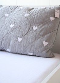 gray and white quilted hearts pillow