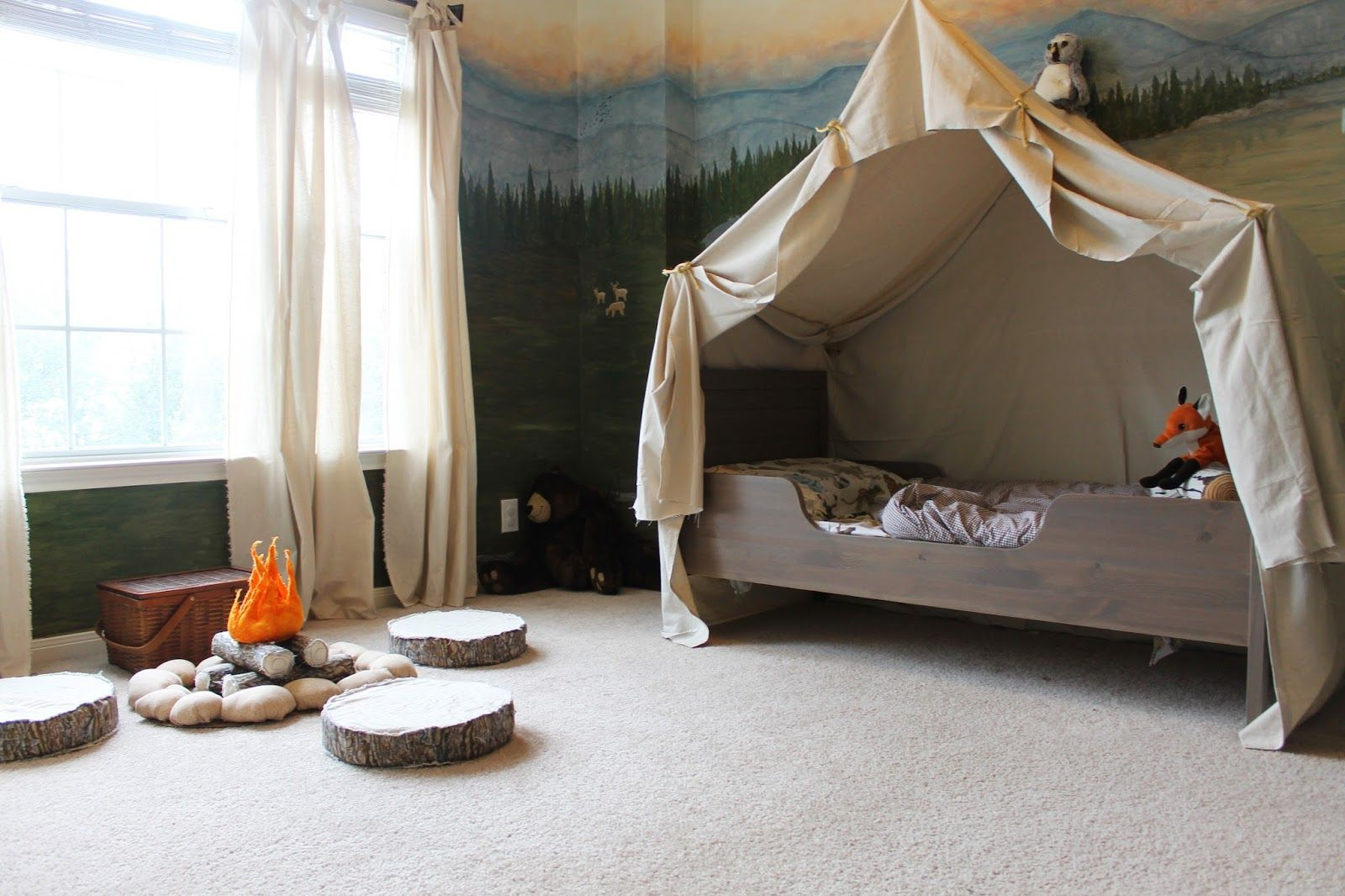 woodland themed kids room with camping tent bed and play campfire ...