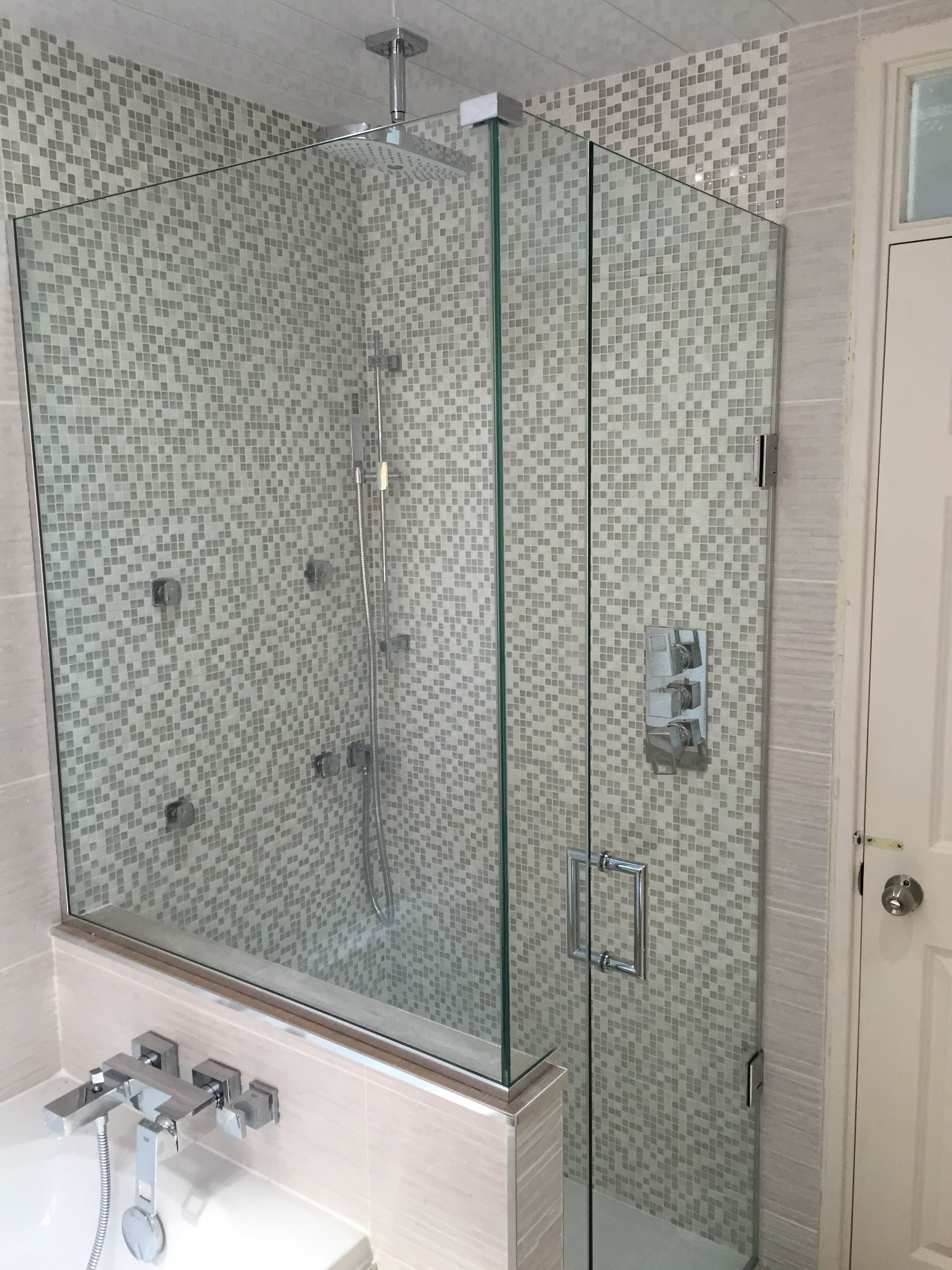 Frameless Made To Measure Shower Enclosure Installed To End Of Bath Over Nib Wall In Middlesbroug Bathroom Wall Panels Bath Shower Enclosures Shower Enclosure