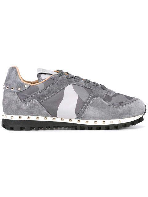 Shop Valentino camouflage panel sneakers .