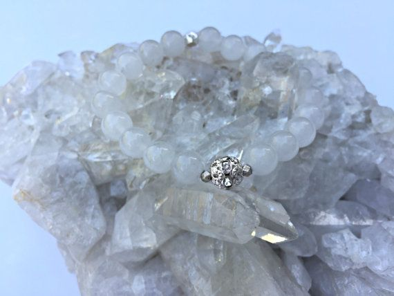 https://www.etsy.com/ca/listing/478042570/8mm-natural-round-snow-quartz-gemstone?ref=shop_home_active_9