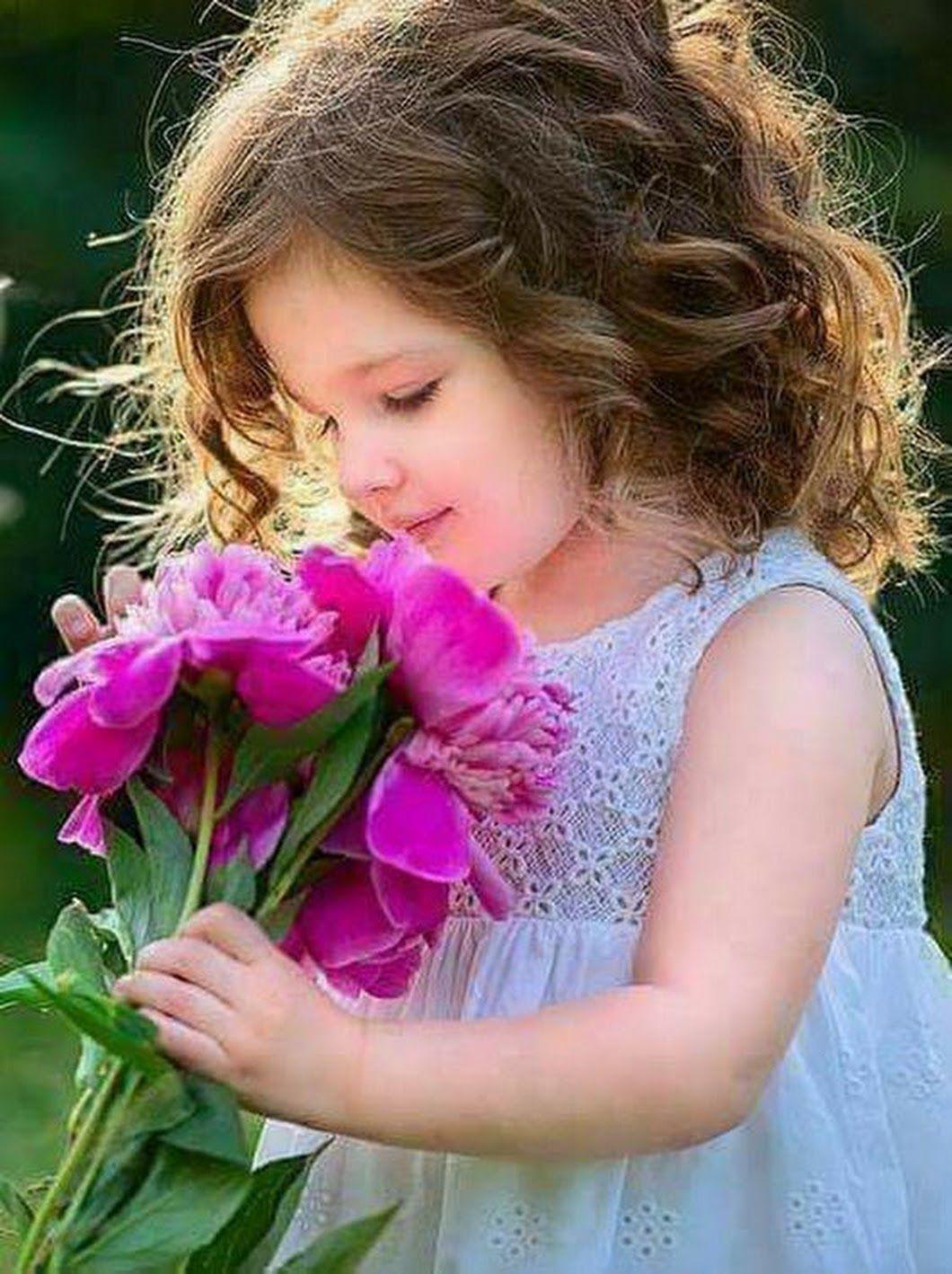 little girl holding flowers. | photography | pinterest | child