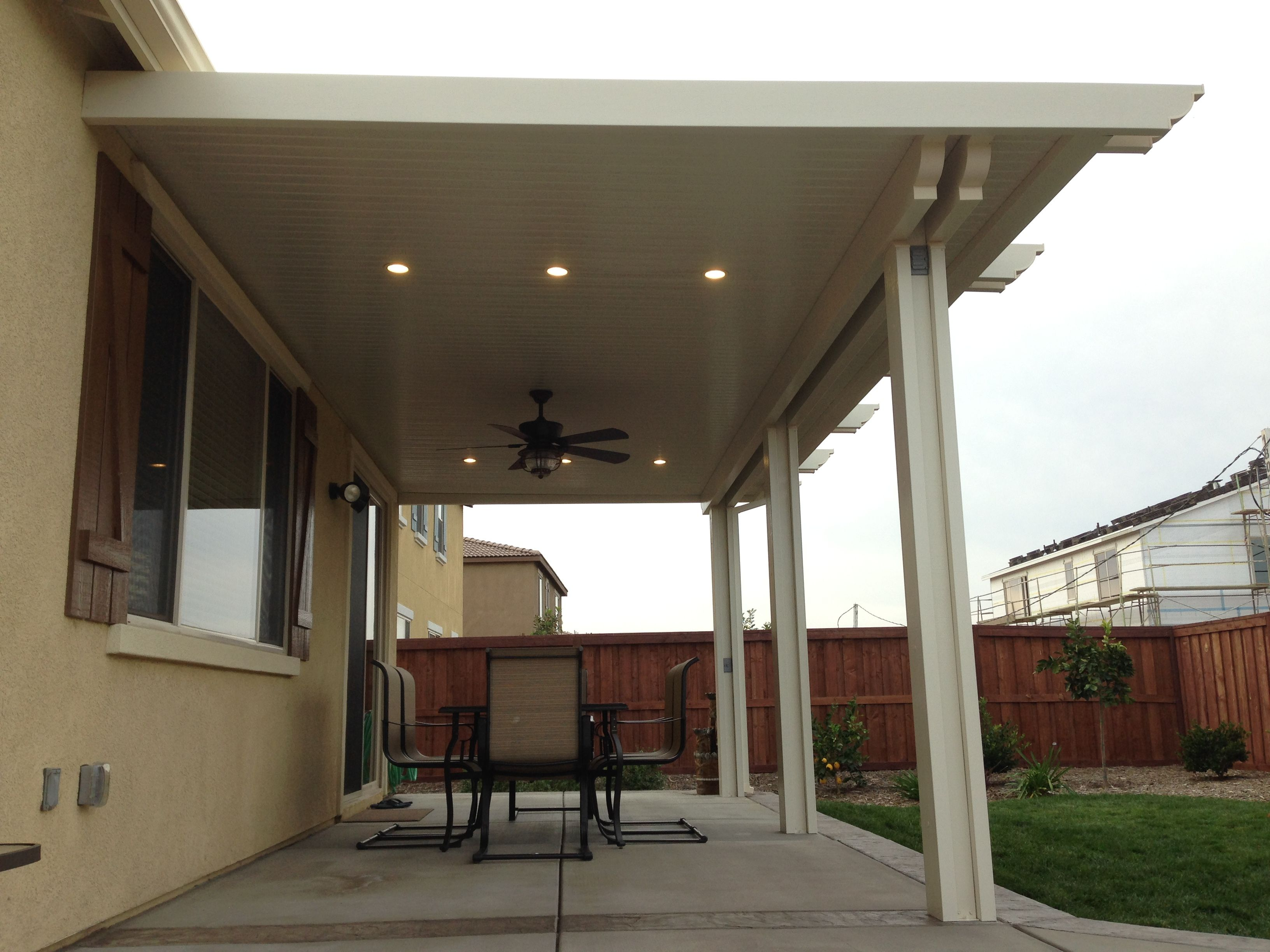 Alumawood patio cover with fan and two lightstrips canned lights