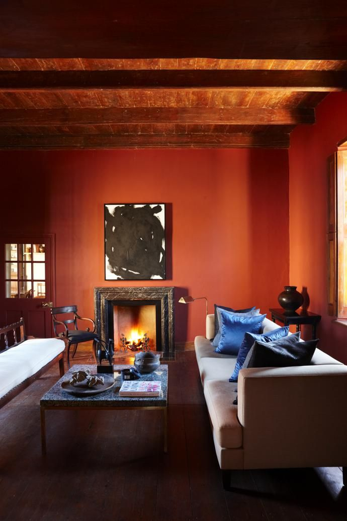 The Sitting Room Has Oxblood Red Walls Shutters That Keep Cool In