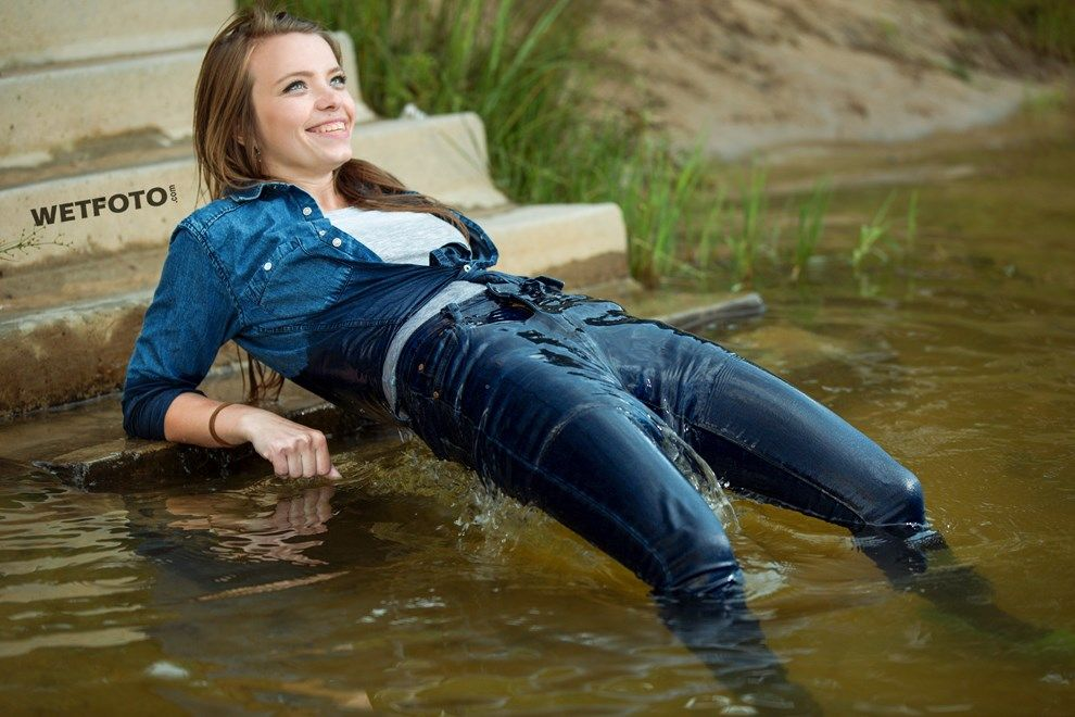 By Smiling Girl In Wet Tight Jeans And Gray T-Shirt -8573