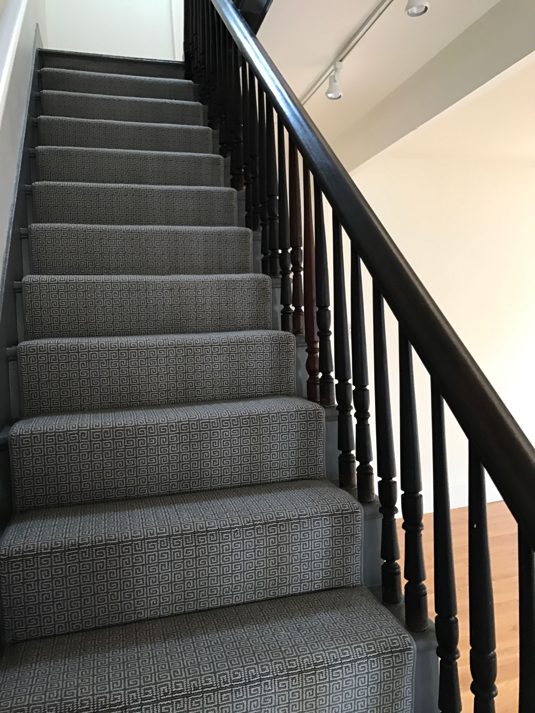 This @bloomsburgusa stair runner we installed looks beautiful on top of these gray stairs! When designing your stair runner project, there are many design decisions to make. Let us help you decide how much wood you'd like to show, how you want the material to fall, or recommend a binding accent color that will help make your choice pop.  Email a photo of your space to info@carpetworkroom.com for a free estimate or fill out a custom carpet order