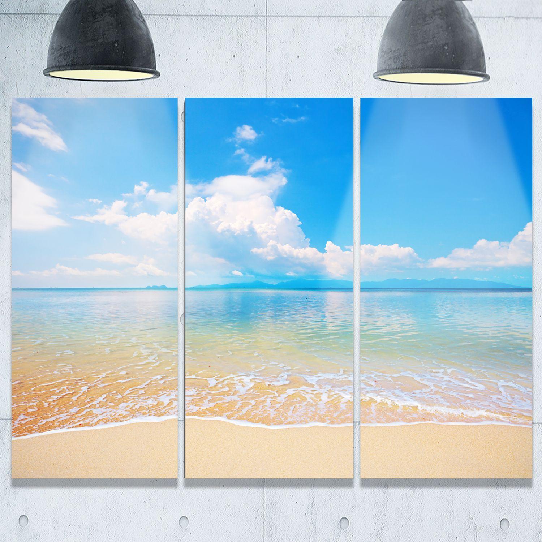 Designart clouds over calm beach seashore photo glossy metal