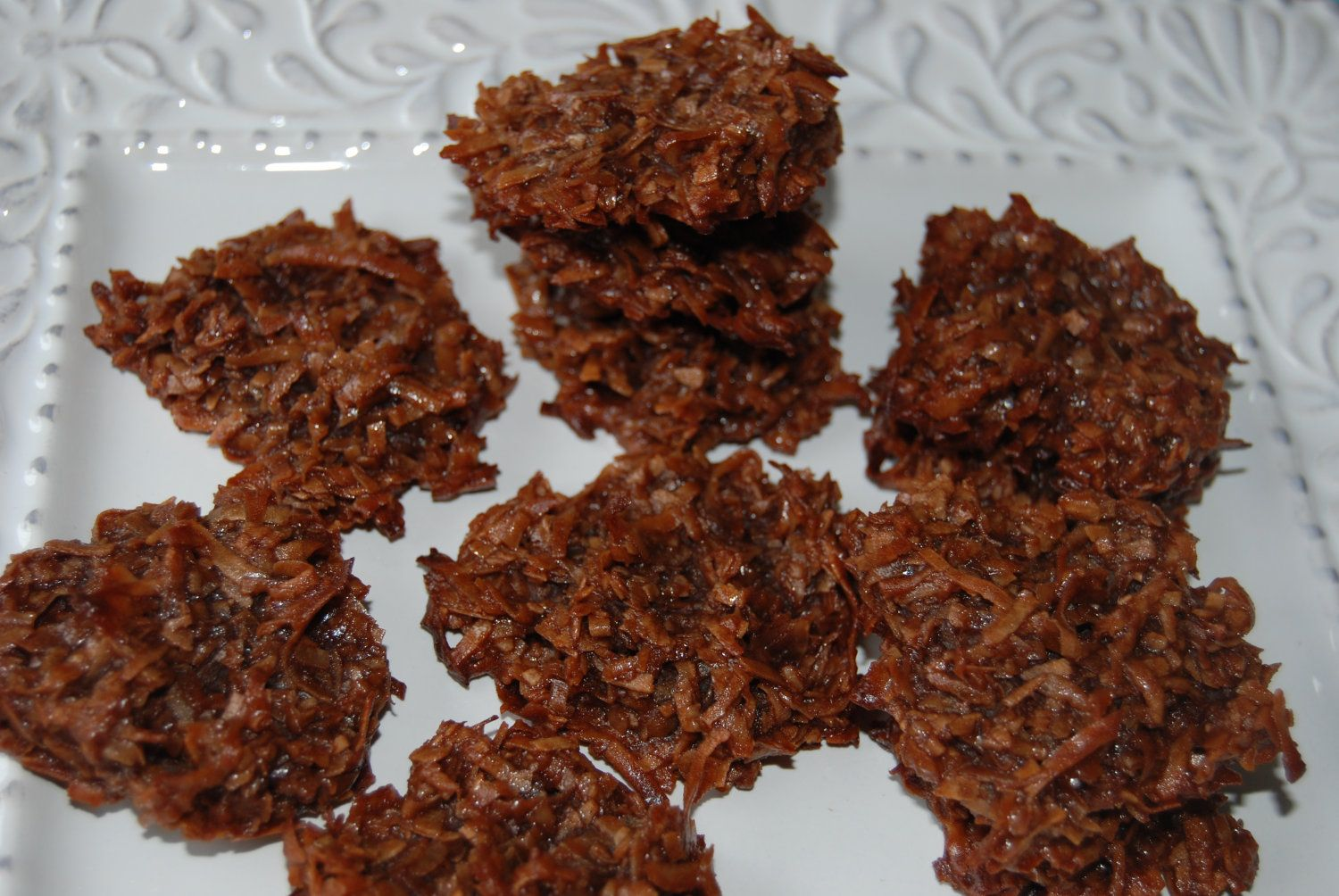 Chewy Chocolate Macaroons (Unsweetened chocolate)  Melt 4oz (1/2 cup) of bitter chocolate. Add 14oz can sweetened condensed milk & 14oz bag of Flake coconut. Mix well. Roll in 1-inch balls (or drop from teaspoon) onto baked, parchment lined cookie sheets. Bake at 350 for 10-12 minutes.