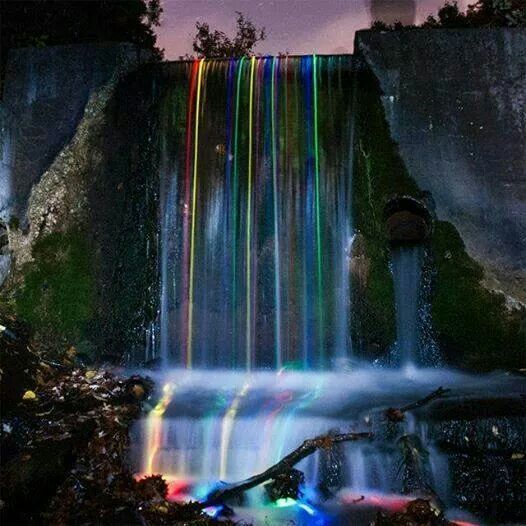 Long exposure of glow sticks dropped into a waterfall.  I hope they retrieved the glow sticks!